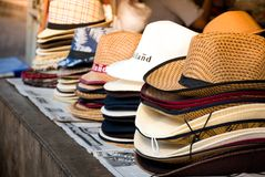 Counter with different hats being sold royalty free stock images