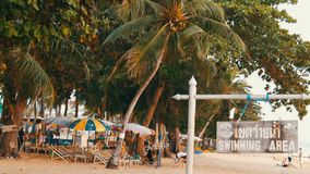 PATTAYA, THAILAND, December 14, 2017: View on the beach promenade with palm trees and coconuts in Thailand. People rest. PATTAYA, THAILAND, December 14, 2017 stock video footage