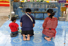 Pattaya, Thailand: Family at Prayer Royalty Free Stock Images