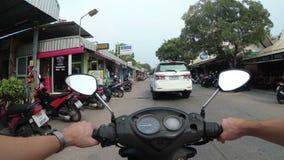 POV view on Riding motorbike along the Asian Road Traffic. Thailand, Pattaya