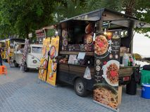 PATTAYA, THAILAND - MAY 8, 2018: Food trucks are selling food and dessert in Pattaya Seafood Festival. PATTAYA, THAILAND - MAY 8, 2018: Food trucks are selling Stock Photo