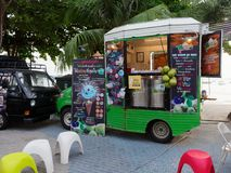 PATTAYA, THAILAND - MAY 8, 2018: Food trucks are selling food and dessert in Pattaya Seafood Festival. PATTAYA, THAILAND - MAY 8, 2018: Food trucks are selling Royalty Free Stock Photo