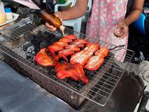 PATTAYA, THAILAND - MAY 25, 2018: Grilled chicken on bbq stove which is famous street food of Thailand. PATTAYA, THAILAND - MAY 25, 2018: Grilled chicken with royalty free stock image