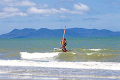 PATTAYA THAILAND -MAY 26, 2013: Man playing windsurfing in the s Stock Image