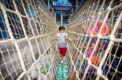 PATTAYA, THAILAND - NOVEMBER 21: A boy makes his way across a br stock image
