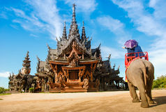 Pattaya, Thailand: Thai Temple Elephant Rides. Visitors to the renowned Sanctuary of Truth in Pattaya, Thailand enjoy an elephant ride conducted by guides around Royalty Free Stock Images