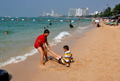Pattaya, Thailand: Two Boys Playing on Beach Royalty Free Stock Photography