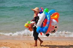 Pattaya, Thailand: Vendor Selling Beach Toys Royalty Free Stock Images