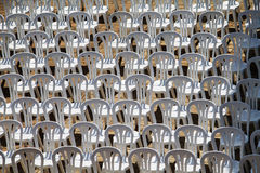 Patter composed by chairs of white plastic Royalty Free Stock Photos