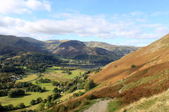 Patterdale, Glenridding and Ullswater, Cumbria. View from the mountainside footpath up to Angle Tarn looking North West across he valley to Patterdale and Royalty Free Stock Photos