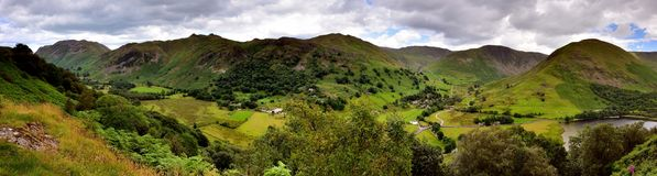 Dark clouds over the Patterdale and Harstop valleys. The Patterdale and Hartsop valley from Low Wood Stock Photo