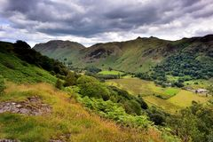 Dark clouds over the Patterdale common. The Patterdale valley from Low Wood Royalty Free Stock Photos