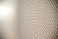 Pattern. Close up of perforated pattern with selective focus Stock Photography