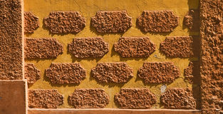 Pattern on adobe wall Stock Photos