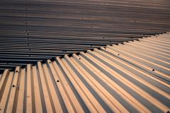 Pattern of the aluminium roofing during sunset. royalty free stock photo
