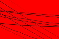 Crossed Wires over a dark red background. This pattern of an array of crossed wires combines direction with misdirection Royalty Free Stock Photo
