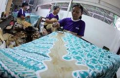 Pattern of batik using canting. Traditional batik craftsmen worked on the cultivation pattern of batik using canting in Ndalem Wuryaningratan Surakarta , Central royalty free stock image
