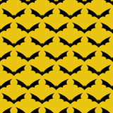 Pattern with bats. Seamless pattern with frightful black colored flying bats with evil yellow colored eyes and sharp ears isolated on yellow background. For Stock Photo