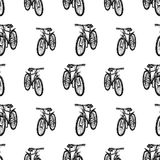 Pattern of the bicycles sketches. Seamless background of the city bikes for strolls Stock Image