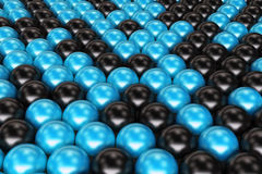 Pattern of black and blue spheres. Shiny balls. Abstract background. 3D rendering illustration Stock Photo