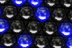 Pattern of black and blue spheres. Shiny balls. Abstract background. 3D rendering illustration Stock Photography
