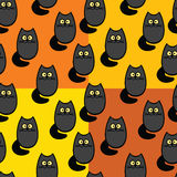Pattern with black cats on an orange and yellow background Stock Photo