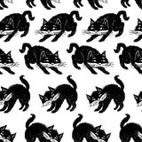 Pattern of the black cats. Seamless background of the cartoons black cats Stock Photography