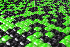 Pattern of black and green spheres. Shiny balls. Abstract background. 3D rendering illustration Stock Photography