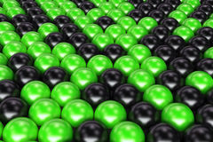 Pattern of black and green spheres. Shiny balls. Abstract background. 3D rendering illustration Stock Image