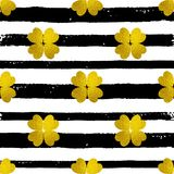 Pattern with black lines and golden clover Royalty Free Stock Images