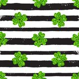 Pattern with black lines and green clover Royalty Free Stock Image