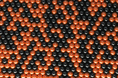 Pattern of black and orange spheres. Shiny balls. Abstract background. 3D rendering illustration Royalty Free Stock Images