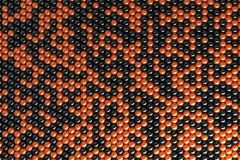 Pattern of black and orange spheres. Shiny balls. Abstract background. 3D rendering illustration Stock Photos