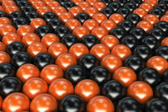 Pattern of black and orange spheres. Shiny balls. Abstract background. 3D rendering illustration Stock Photo