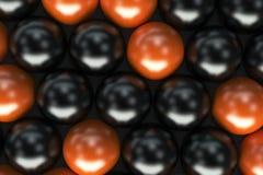 Pattern of black and orange spheres Stock Photos