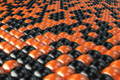 Pattern of black and orange spheres Royalty Free Stock Image