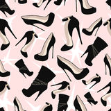 Pattern of black shoes with glitter on a pink background Royalty Free Stock Images