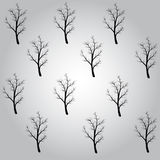 Pattern of a black trees. Is on the gray background Stock Photos