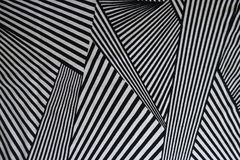 Pattern of black and white lines on fabric. From above royalty free stock photography