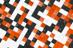 Pattern of black, white and orange cubes with deformed surfaces. Wall of deformd cubes. Abstract background. 3D rendering illustration Stock Photography