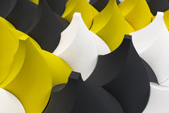 Pattern of black, white and yellow twisted pyramid shapes Stock Photo