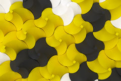 Pattern of black, white and yellow twisted pyramid shapes Royalty Free Stock Images