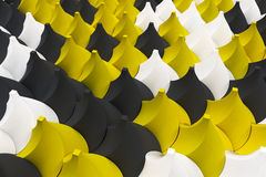 Pattern of black, white and yellow twisted pyramid shapes Royalty Free Stock Photo