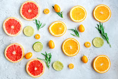 Pattern with blood orange and lime on gray background top view Royalty Free Stock Image