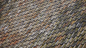 Orange, blue and green pattern from roof Stock Images