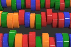 Pattern of blue, red and green cylinder tablets on black background. Plastic pucks. Abstract background. 3D rendering illustration Royalty Free Stock Photography