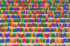 Pattern of blue, red and green cylinder tablets on white background. Plastic pucks. Abstract background. 3D rendering illustration Stock Images
