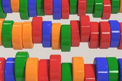 Pattern of blue, red and green cylinder tablets on white background. Plastic pucks. Abstract background. 3D rendering illustration Royalty Free Stock Photography