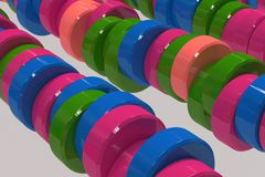 Pattern of blue, red and green cylinder tablets on white background. Plastic pucks. Abstract background. 3D rendering illustration Royalty Free Stock Photo