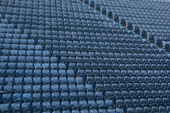 Pattern of blue seats in stadium. Rows of blue plastic seats at football / soccer stadium Stock Photo